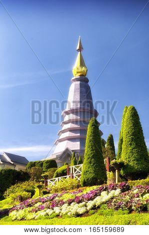 The top of the queens Pagoda against at blue sky in Doi Inthanon National Park Thailand on a sunny day.