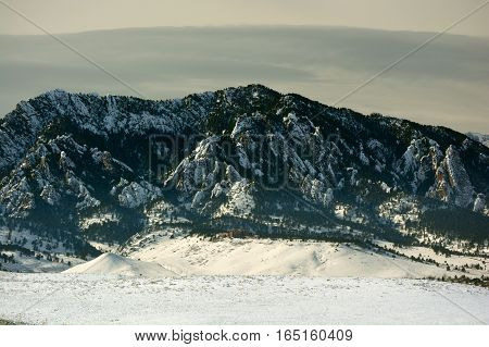 Flatirons Mountains in Boulder Colorado on a Cold Snowy Winter Day with the National Center for Atmospheric Research