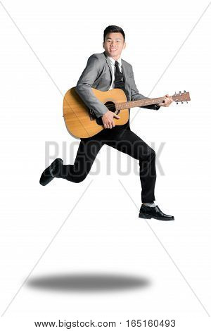 Young business man jumping with guitar. Isolated on white background