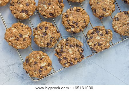 Flourless gluten free peanut butter oatmeal and chocolate chips cookies on parchment top view copy space horizontal
