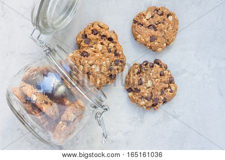 Flourless gluten free peanut butter oatmeal and chocolate chips cookies in glass jar top view horizontal
