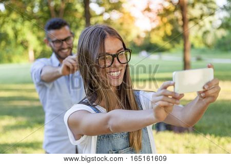 Lovely Couple Of Young Adults Take A Selfie In The Park