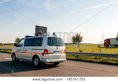 VIENNA AUSTRIA - SEP 30 2014: White Volkswagen maintenance security van from ASFiNAG tool road company. The ASFiNAG is an Austrian publicly owned corporation which plans finances builds maintains and collects tolls for the Austrian autobahns. The ASFiNAG