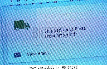 LONDON UNITED KINGDOM - OCTOBER 20 2014: Shipped via La Poste items from Amazon.fr text on computer screen with the optiion to track the parcels and view email.