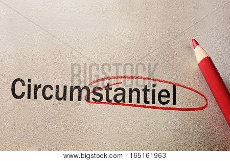 Red circle around a misspelled word with pencil on textured paper
