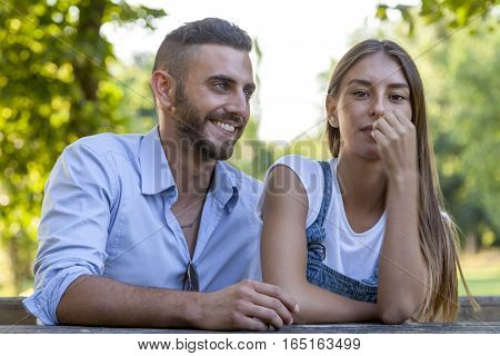 Beautiful Couple Of Young Adults Relaxing In The Park