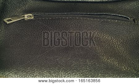 The black expensive quality leather male purse close-up