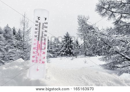 Thermometer on snow showing very low temperature