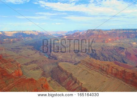 rock formation and sweeping vista of the Grand Canyon