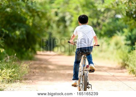 Young Boy Ride Bicycle