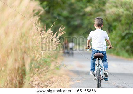 Boy Ride Bicycle