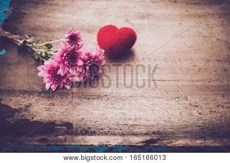 Red heart and pink flower - concept of love story nostalgia and remembrance in valentine's day. vintage color tone