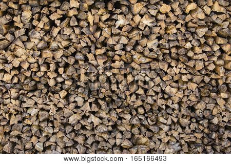 Dry chopped firewood logs ready for winter Nepal . Close up. Wood stock background