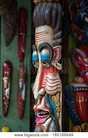 Colorful wooden masks and handicrafts on sale at shop in the Thamel District of Kathmandu Nepal.. Close up poster