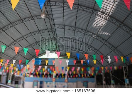 Colorful flags in school swimming pool stock photo