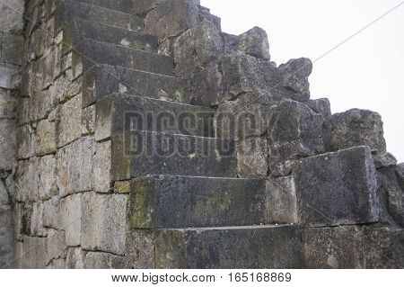 beautiful old stone stairs natural dark stone diabase with stone steps.