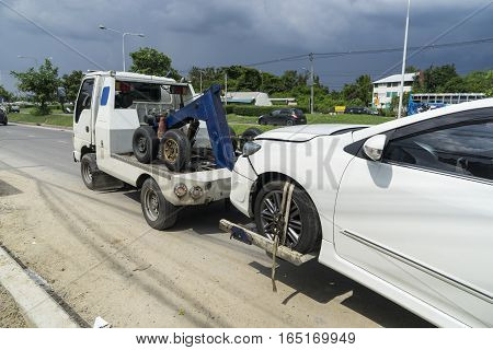 accident car and forklift take a car on the road - can us e to display or montage on product