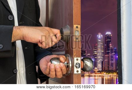 businessman open door to night cityscape - can use to display or montage on product