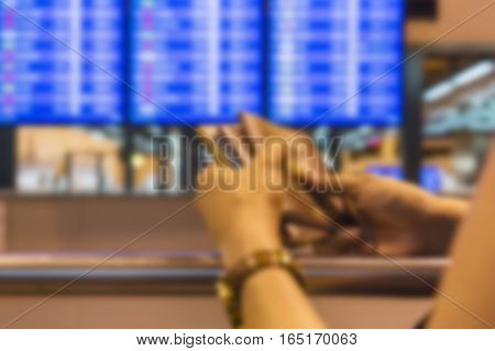 abstract blur background of scene girl waiting in the airport - can use to display or montage on product