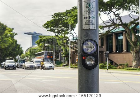 button for walk cross the road in downtown singapore - can use to display or montage on product