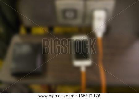 abstract blur scene of charging mobile phone - can use to display or montage on product