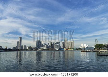 abstract cityscape at waterfront in day time blue sky - can use to display or montage on product