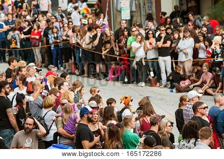 ATLANTA, GA - OCTOBER 2016:  Hundreds of spectators line the parade route as they wait for the start of the annual Little Five Points Halloween parade in Atlanta GA on October 15 2016.