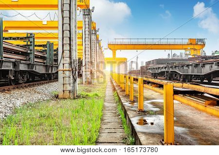 Pier bridge crane and cargo handling cargo trains transported away.