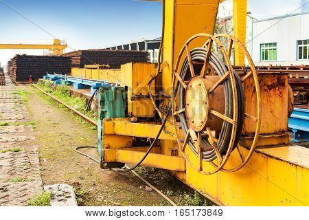 Pier bridge crane and cargo handling cargo trains transported away.