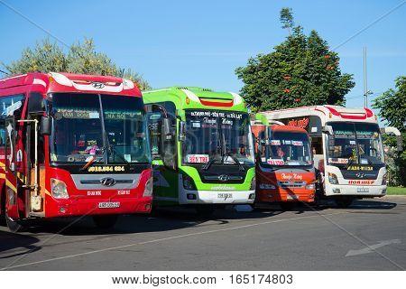DA LAT, VIETNAM - DECEMBER 28, 2015: Four intercity buses on the parking of the intercity transport terminal