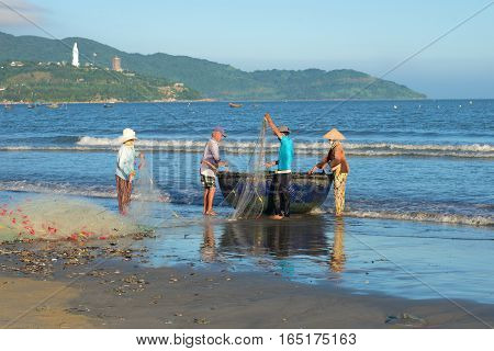 DANANG, VIETNAM - JANUARY 04, 2016: Fishermen are placed in the network in the boat before going for fishing
