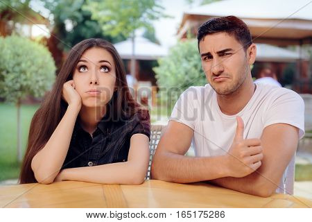 Woman and Man on a Boring Bad Date at the Restaurant
