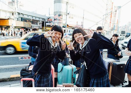 Tokyo Japan - 20 October 2016 - Group of japanese school girls with luggage for travel in tokyo