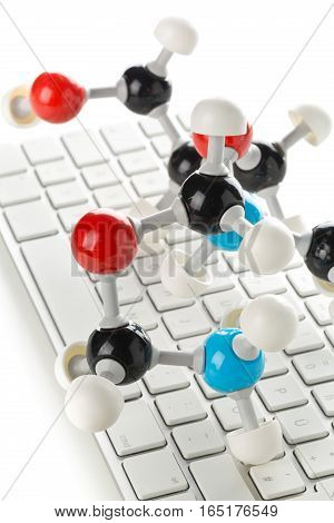 Chemical molecule model on computer keyboard. Artificial intelligence concept