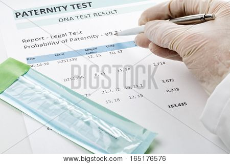 Paternity DNA test result chart form - doctor pointing at result value