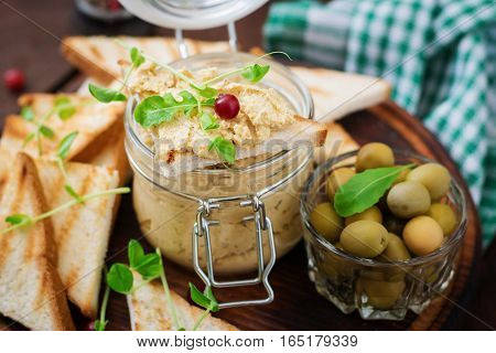 Pate Chicken - Rillette, Toast, Olives And Herbs On A Wooden Board