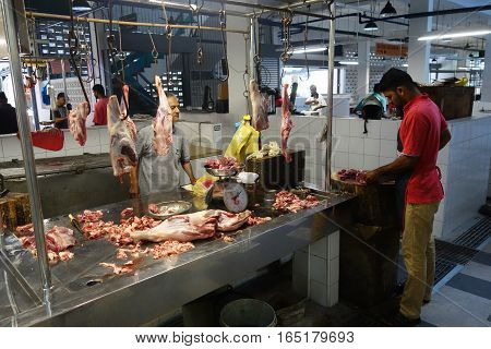 Unidentified Indian Butcher Sits At His Butcher Shop