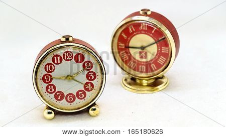 Two old metal table alarm clock. .