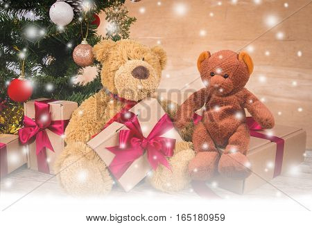 Teddy bear with brown gift box and chirstmas tree on wooden background