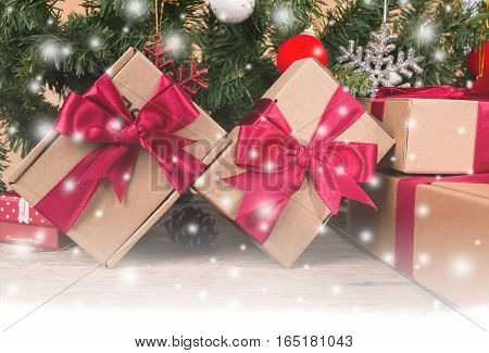Brown gift box and chirstmas tree on wooden background