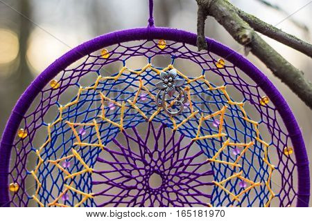 purple Dreamcatcher made of feathers leather beads and ropes hanging