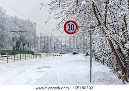 Speed limit sign with white winter background