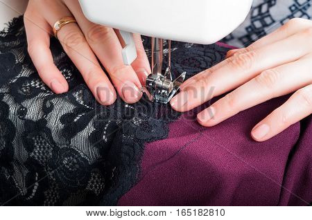 Sewing dress with sewing machine by hand