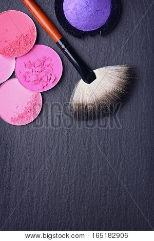 Brush For Make Up And Blush And Eye Shadow On Black Slate Background
