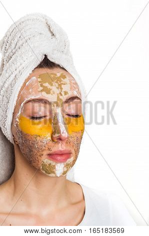 Woman with different masks on her face multi-masking