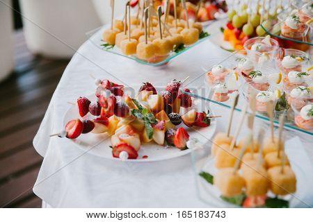 Fruit on a white plate. Dessert fruit.
