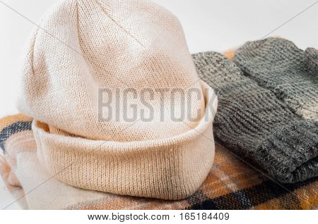 Mittens scarf and hat on withe background