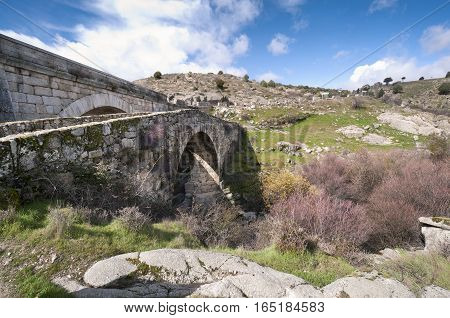 Grajal Bridge over the river Manzanares, Colmenar Viejo, Madrid, Spain. It was built in Middle Age during the Muslim domination of the Iberian Peninsula
