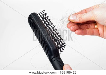 Hair loss - pulling hair out of the plastic hair brush by hand