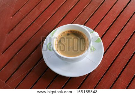 coffee espresso on the wood floor background
